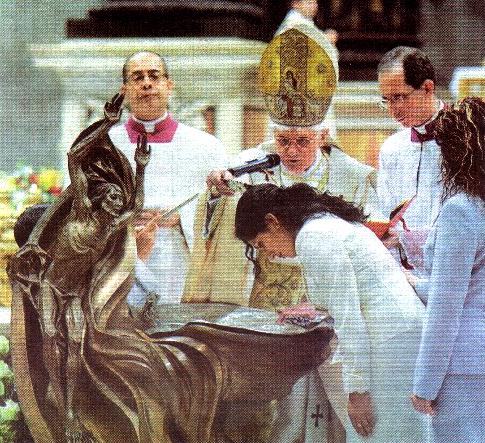 Anti Pope Benedict XVI baptizing a woman