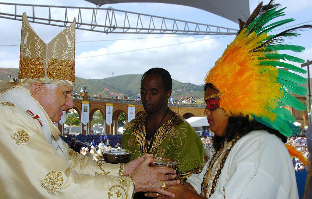 Anti Pope Benedict XVI in Brazil with natives woman at altar during mass