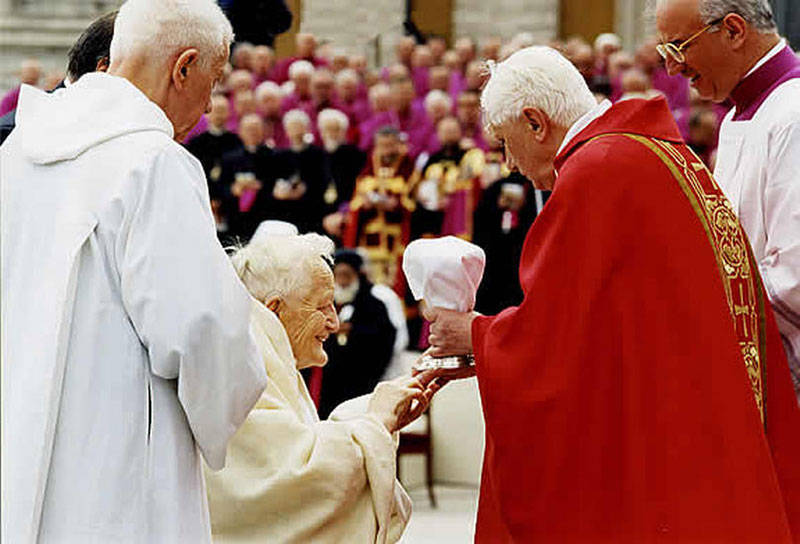 "Anti Pope Benedict XVI giving ""communion"" in the hand to non-Catholic Roger Schutz"
