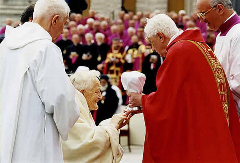 "Anti Pope Benedict XVI giving ""communion"" in the hand to non-Catholic Roger Schutz"